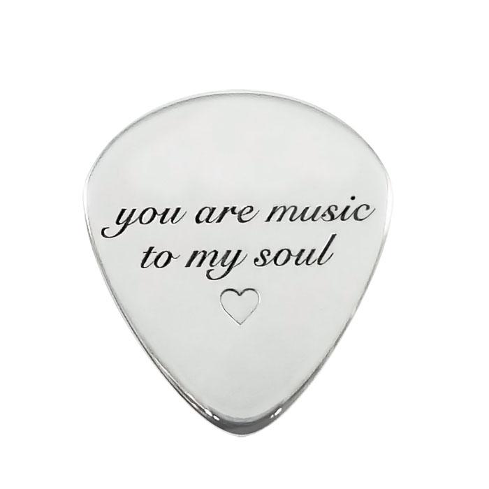 Silver guitar pick